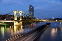 Frankfurt. Coal barge travelling beneath a bridge in Frankfurt, Germany at night stock photos