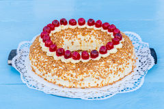 Frankfurt crown cake with cherries on a blue wood Royalty Free Stock Image