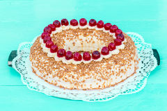 Frankfurt crown cake with cherries on a turquoise wood Stock Photography