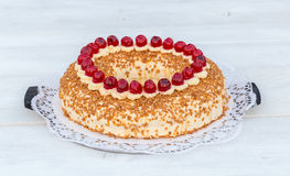 Frankfurt crown cake with cherries on white wooden Stock Photo