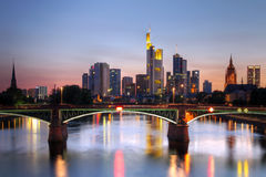 Frankfurt, Germany. River view at twilight of Frankfurt am Main in Germany (Hesse). Most iconic buildings (skyscrapers) are visible, together with the tower of royalty free stock photography
