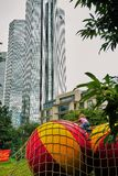 Little girl climbs huge beach balls in the urban jungle of downtown Frankfurt stock image