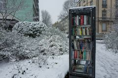 Frankfurt, Germany - December 03: A bookshelf in the snow on December 03, 2017 in Frankfurt, Germany royalty free stock photography