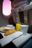 FRANKFURT, GERMANY - JAN 21st, 2017: breakfast on an airplane in Lufthansa Business Class with fresh coffee, orange. Juice, cheese and bacon stock photo