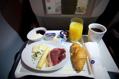 FRANKFURT, GERMANY - JAN 21st, 2017: breakfast on an airplane in Lufthansa Business Class with fresh coffee, orange. Juice, cheese and bacon stock photography