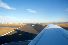 FRANKFURT, GERMANY - JAN 20th, 2017: Civil jet airplane making turn on the runway, preparing for departure wing view Stock Images