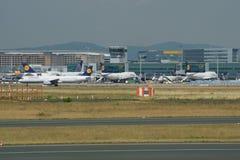 FRANKFURT, GERMANY - JUN 09th, 2017: Aircrafts standing near the terminal 1 at Frankfurt Main airport at the gate or royalty free stock photo