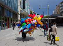 Frankfurt, Germany - June 15, 2016: The dealer of colorful balloons walking along the Zeil in Midday Stock Photography