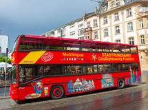 Frankfurt, Germany - June 15, 2016: A double-decker tourist sightseeing bus at Paulsplatz square in Old Town. Royalty Free Stock Images