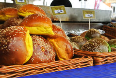 FRANKFURT, GERMANY - JUNE 6, 2017: A set of fresh burger buns of different color with sesame seeds in the baskets Royalty Free Stock Photos