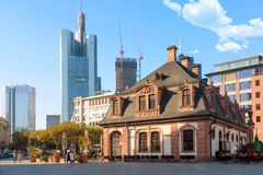 Frankfurt, Germany - November, 2018: Historic Hauptwache Cafe located against business skyscrapers in the centre of Frankfurt am royalty free stock photo
