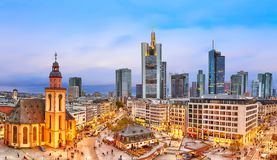 FRANKFURT, GERMANY - NOVEMBER, 2017: View to skyline of Frankfurt in sunset blue hour. St Paul`s Church and the Hauptwache Main G. Uard building at Frankfurt Royalty Free Stock Photo