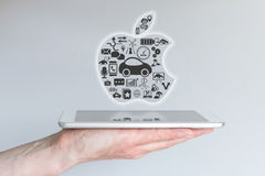 Frankfurt, Germany - October 25, 2015: Male hand holding iPad tablet with concept of Apple iCar. Using Apple logo as illustration Royalty Free Stock Photography