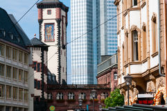 Frankfurt Germany Old and Modern Architecture. City scene. In foreground structure of the old part of Frankfurt, Germany, including a clock tower and pedestrian Stock Photography