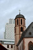 Frankfurt Germany Old and New. View of an old church and newer apartment and office buildings in Frankfurt Germany Royalty Free Stock Image