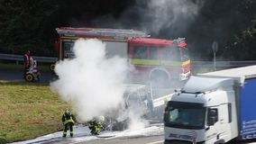 Burning truck on the highway. Frankfurt, Germany - Sep 19, 2017: Burning truck on the highway in germany. Firemen extinguish the fire stock footage