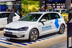 FRANKFURT, GERMANY - SEPT 2019: white VOLKSWAGEN VW E-GOLF small electric car, IAA International Motor Show Auto Exhibtion