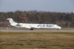 Frankfurt International Airport – Adria Airways Canadair 900 takes off. The Adria Airways Canadair CRJ-900LR with identification S5-AAU takes off at stock image