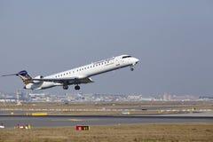 Frankfurt International Airport – Lufthansa CityLine Canadair 900 takes off Stock Image