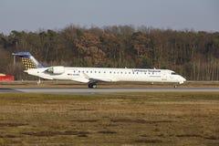 Frankfurt International Airport – Lufthansa CityLine Canadair 900 takes off Stock Photo