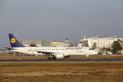 Frankfurt International Airport – Lufthansa CityLine Embraer 190 takes off Royalty Free Stock Photo