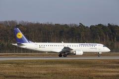 Frankfurt International Airport – Lufthansa CityLine Embraer 190 takes off Royalty Free Stock Image