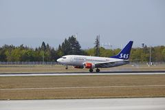 Frankfurt International Airport - Boeing 737 of SAS lands Royalty Free Stock Image