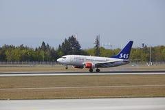 Frankfurt International Airport - Boeing 737 of SAS lands Royalty Free Stock Image