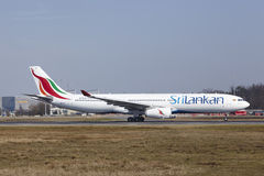 Frankfurt International Airport - SriLankan Airlines Airbus A330 takes off. The SriLankan Airlines Airbus A330-343 with identification 4R-ALP takes off at stock photography