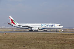 Frankfurt International Airport - SriLankan Airlines Airbus A330 takes off. The SriLankan Airlines Airbus A330-343 with identification 4R-ALP takes off at royalty free stock photography