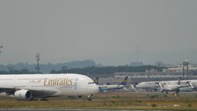 Emirates Airbus 380 taxiing. Frankfurt Am Main, Germany - July 17, 2017: Airbus 380 Emirates A6-EOC taxiing after landing. Fraport, Frankfurt, Germany stock video footage
