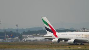 Emirates Airbus 380 taxiing. FRANKFURT AM MAIN, GERMANY - JULY 17, 2017: Airbus 380 Emirates A6-EOC taxiing after landing. Fraport, Frankfurt, Germany stock footage