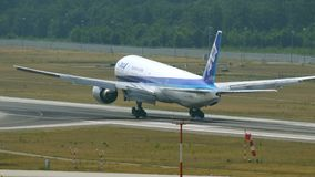 All Nippon Airways Boeing 777 on final approach stock footage