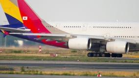 Asiana Airbus 380 taxiing. FRANKFURT AM MAIN, GERMANY - JULY 18, 2017: Asiana Airlines Airbus 380 HL7625 turn runway 25C before departure. Fraport, Frankfurt stock footage
