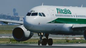 Alitalia Airbus A320 taxiing on runway stock video footage
