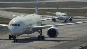 Boeing 787 of Japan Airlines taxiing stock footage