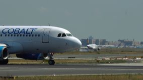 Cobalt Air Airbus A319 on taxiway stock video