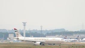 Etihad Airbus A330 taxiing. FRANKFURT AM MAIN, GERMANY - JULY 17, 2017: Etihad Airbus A330 taxiing after landing. Fraport, Frankfurt Germany stock video footage