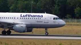 Lufthansa Airbus A319 taxiing. FRANKFURT AM MAIN, GERMANY - JULY 18, 2017: Lufthansa Airbus A319 taxiing after landing at 07L. Fraport, Frankfurt, Germany stock video footage