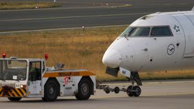 Bombardier CRJ-900 towing to service stock footage