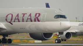 Two newest aircraft of the Airbus family. FRANKFURT AM MAIN, GERMANY - JULY 19, 2017: Qatar Airways Airbus 350 A7-ALL turn to start before departure at runway 18 stock video footage