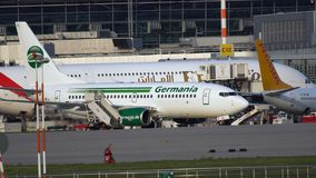 Boeing 737 of Fly Germania rides past the aircrafts at the airport. Frankfurt Am Main, Germany - July 20, 2017: Side view of Boeing 737 D-AGEQ of Fly Germania stock video footage
