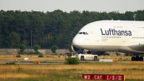Towing Lufthansa Airbus 380 stock footage