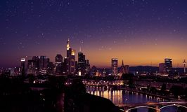 Frankfurt am Main skyline at night with stars. Frankfurt am Main skyline at night with many stars in the sky Stock Photography