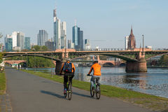 Frankfurt am main skyscraper building with people bicycling Royalty Free Stock Image