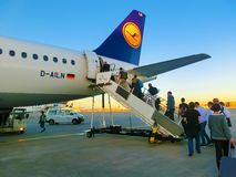 Frankfurt am Mine, Germany - June 15, 2016: The people boarding the Lufthansa Airline aircraft. Passenger walking to the Stock Images