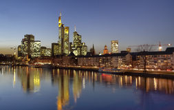 Frankfurt by night. Skyline of Frankfurt, Germany, finance centre over Meno river during a winter sunset with reflex over the water Stock Photo