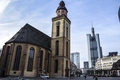 Frankfurt. Old church and modern skyscraper royalty free stock image