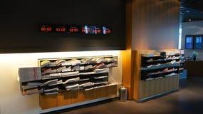 FRANKFURT - SEPTEMBER 2014: First Class Terminal - newspaper rack and world clock Royalty Free Stock Images