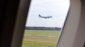 FRANKFURT - SEPTEMBER 2014: view out of an airplane, plane landing Stock Photography